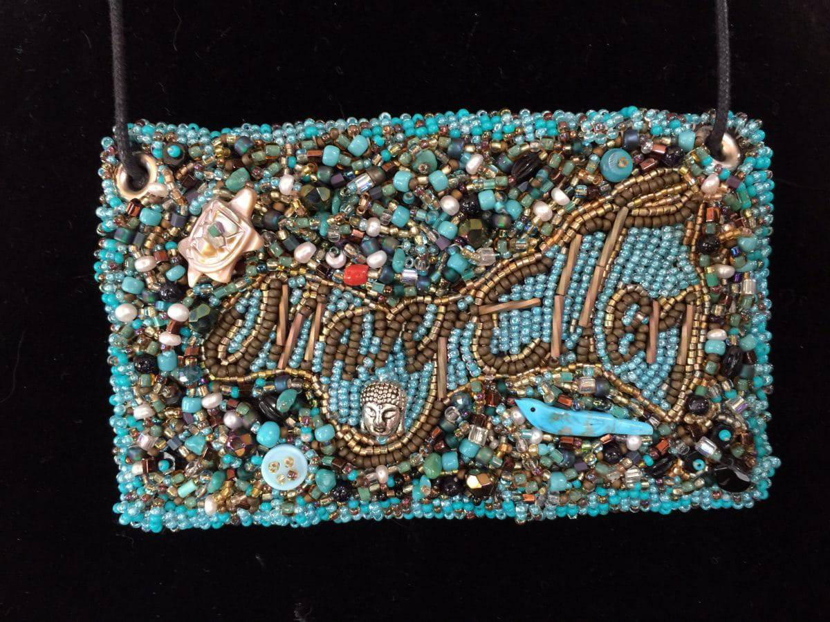 This name tag jewelry is the third of art show entries for Mary Ellen Beads.