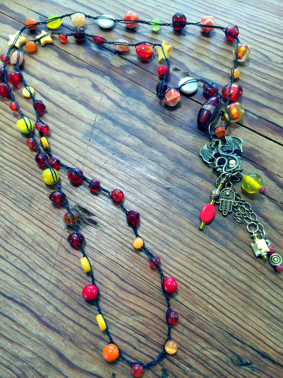 This bead crochet necklace reflects happy charms.
