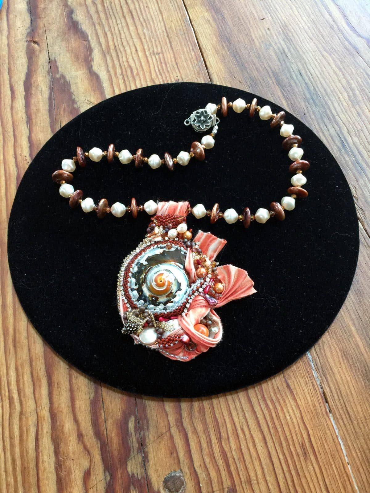 This nautilus beadweaving necklace called Beauty of the Sea at Sunrise is by Mary Ellen Beads, Albuquerque.