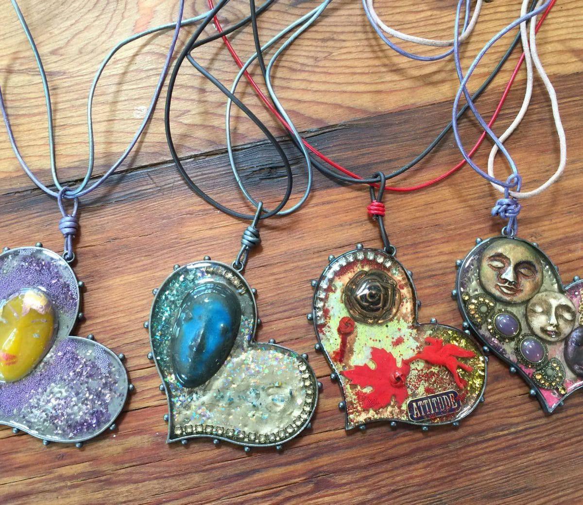 These faces showcase the leather jewelry and ice resin jewelry of Mary Ellen Beads Albuquerque.