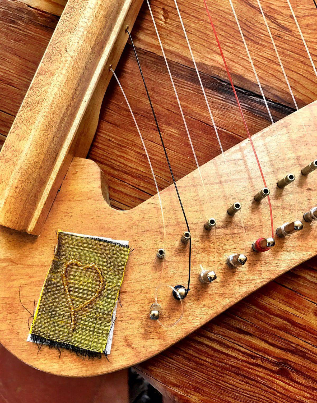 ©2016, Mary Ellen Merrigan, This picture illustrates the Little fingering component for beyond brainstorming in the making of an embellished harp by Mary Ellen Beads Albuquerque.