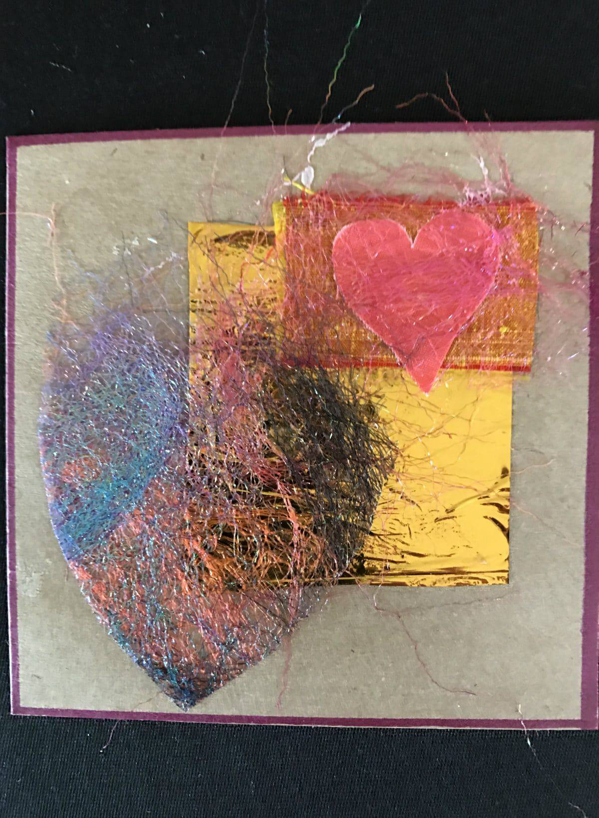 This is a heart shape cut from fused Angelina fibers by Mary Ellen Beads Albuquerque.