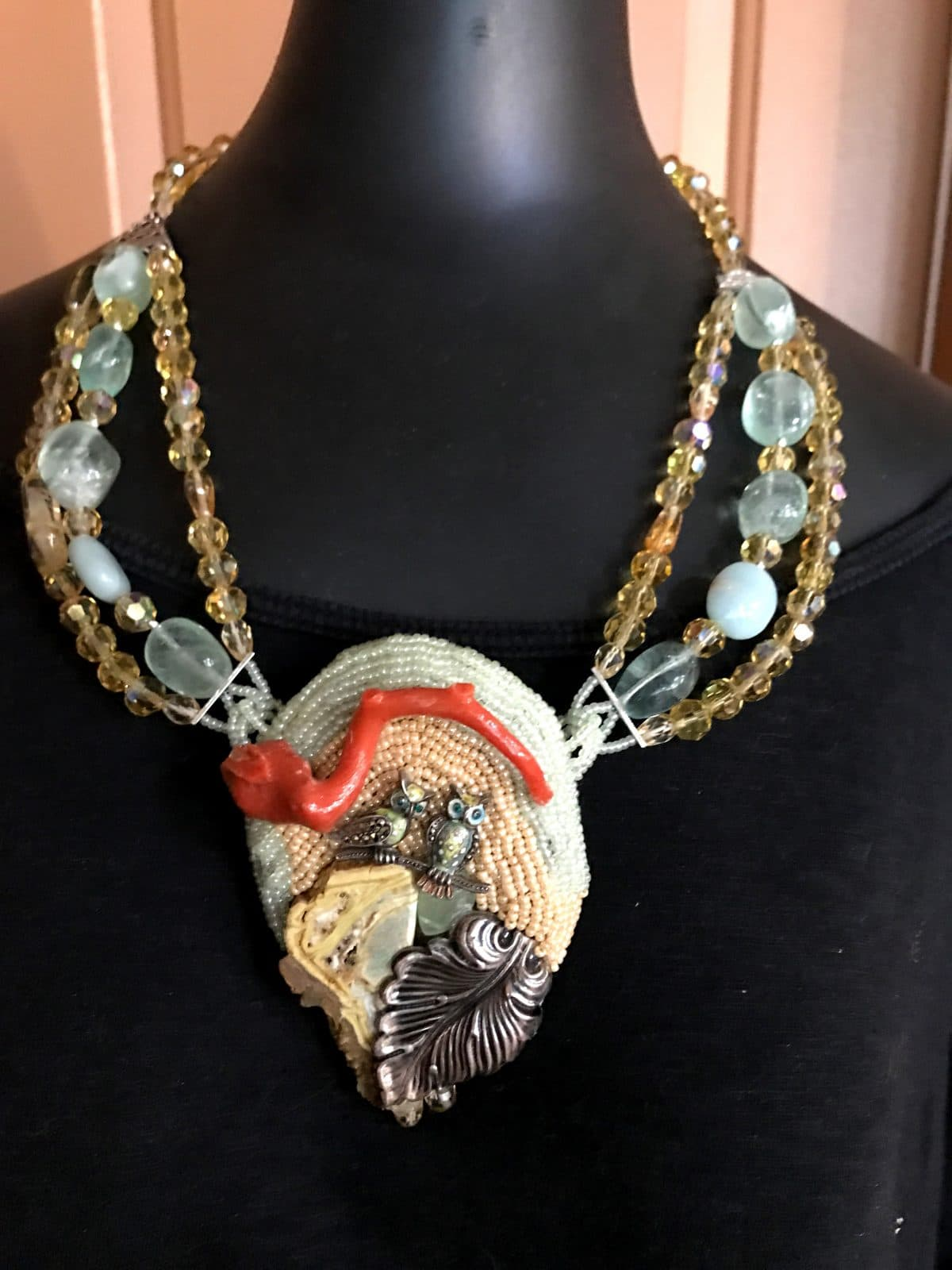 This necklace called Owly depicts the energy of completion for Mary Ellen Merrigan of Mary Ellen Beads Albuquerque.