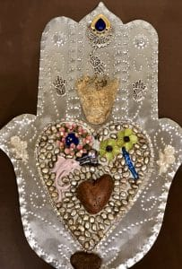 This heart and hand class project is by Donna B. during a class from Mary Ellen Beads Albuquerque.