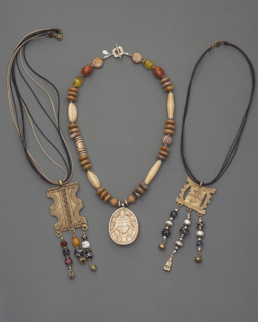 These brass charm necklaces on leather are a part of the symbols and treasures collection from Mary Ellen Beads Albuquerque.
