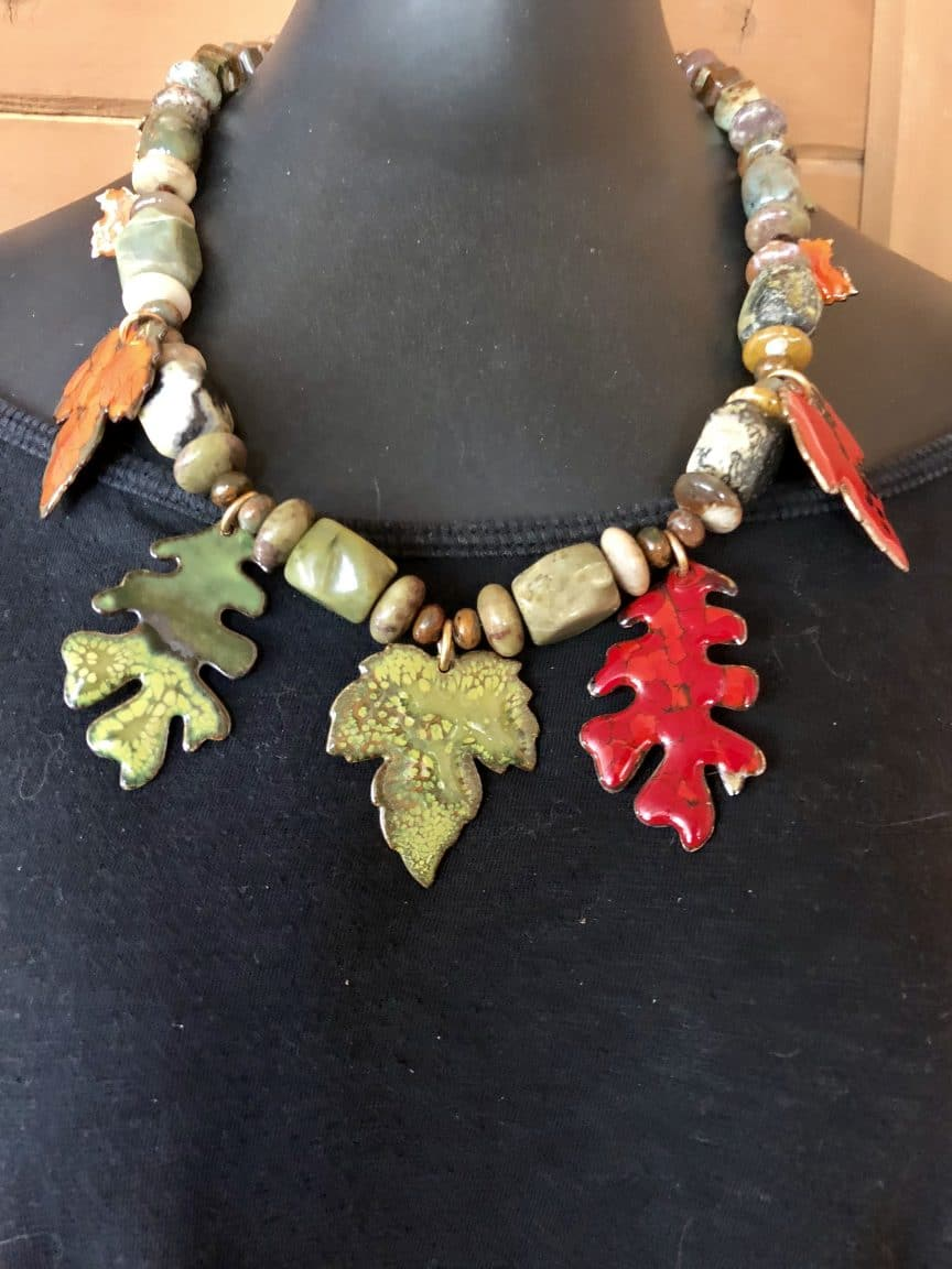 This necklace with its brightly colored enamel leaves is a memory keeper from Mary Ellen Beads Albuquerque.