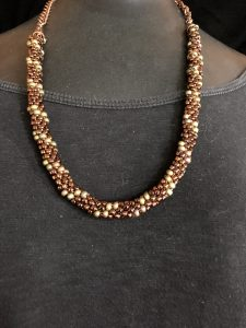 This copper kumihimo necklace is part of the studio tour preparation by Mary Ellen Beads Albuquerque.