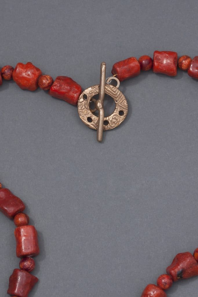 This white bronze clasp, part of a coral necklace was made by Mary Ellen Merrigan and is part of her Beyond a Bead Trunk Show for Mary Ellen Beads Albuquerque