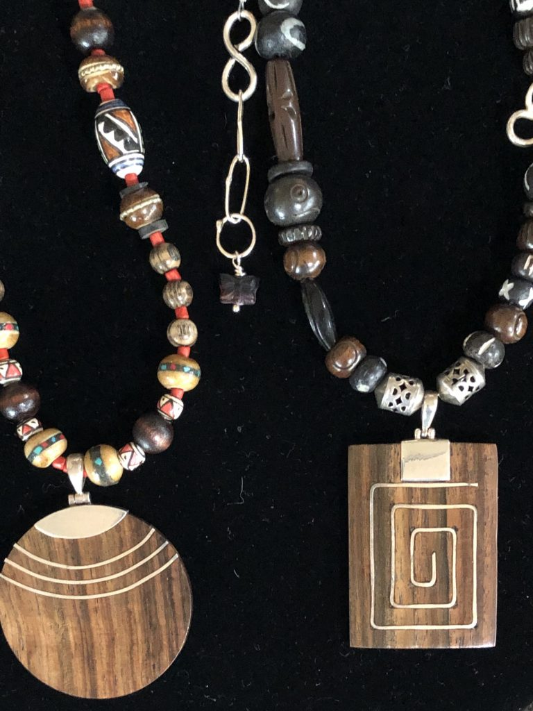These two sterling and wood necklaces are part of a trunk show for Mary Ellen Beads Albuquerque.